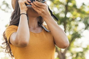 Young woman using the camera.