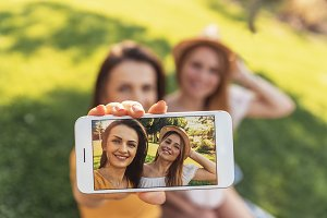 Beautiful women taking a selfie.