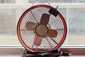 Vintage fan on a window sill