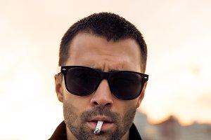 Handsome man smoke cigaret.