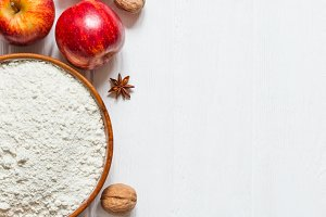 Ingredients for baking on white wooden background