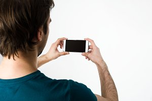Young man taking selfie