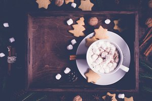 Christmas food background. Tray with cocoa and cookies, decorated with cinnamon and marshmallow