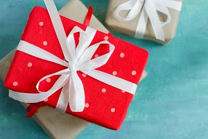 Christmas boxes of gifts festively decorated On a turquoise background