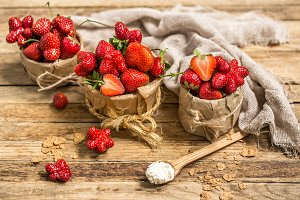 arrangement with fresh strawberries on wooden background
