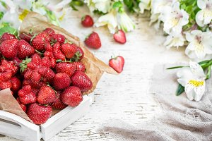 Fresh strawberries on a wooden tray