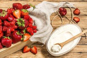 arrangement with fresh strawberries on wooden background