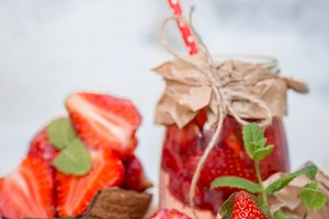 Summer drink with strawberries in a jar