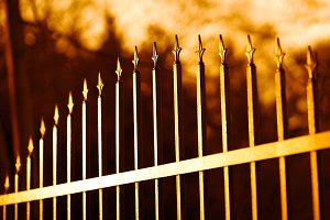 Diagonal sunset fence bokeh background