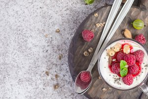 Fresh raspberry berries with yogurt or cream in glasses. Summer Breakfast Dessert Concept