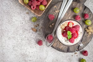 Summer healthy dessert with raspberries and yogurt on the cutting board