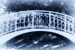 Horizontal blue park arc bridge bokeh vignette abstraction backg