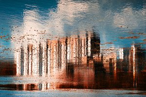Horizontal vivid red abstract town reflection background
