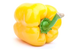 Yellow pepper on the white background