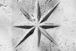 Horizontal black and white star on cracked wall background