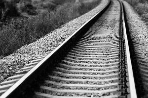 Diagonal black and white railroad track bokeh background