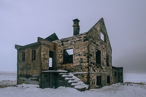 Abandoned House in Winter Landscape