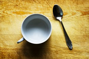 Horizontal empty cup with spoon bokeh background