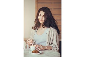 Romantic woman in cafe