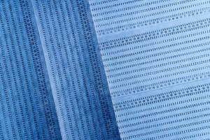 Diagonal vintage blue punched card textured background