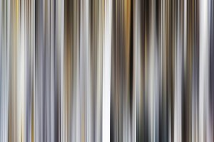 Vertical abstract motion blur grey curtains background backdrop