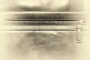 Horizontal vintage leather case with zipper vignette background