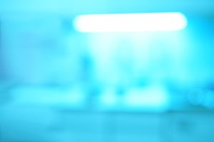 Horizontal cyan incandescence lamp bokeh background