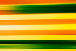 Horizontal green and orange motion blur background