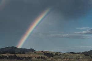 Rainbow over Hills and Rocks