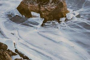 Rock in frozen Lake
