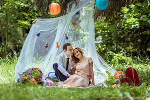 Cheerful couple in the meadow