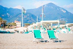 Deckchairs on european beach in Italy in popula area Forte dei Marmi