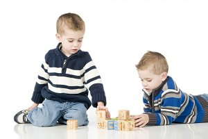 Twin brother playing