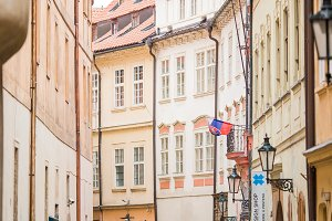 Old narrow street in Europe. District of the city of Prague, Czech Republic, and one of its most historic regions.