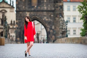 Happy young urban woman in european city. Travel tourist woman in Prague outdoors during holidays in Europe.