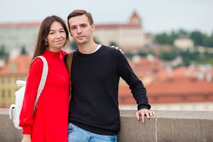 Romantic couple enjoy holidays in Europe. Happy family enjoying vacation on their honeymoon