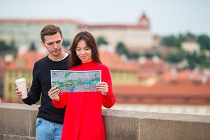 Romantic couple walking together in Europe. Happy lovers enjoying cityscape with famous landmarks.