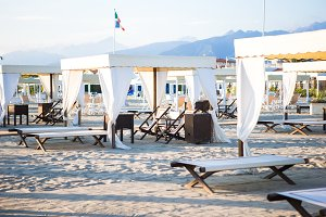 Sunbeds and loungers on european sand beach