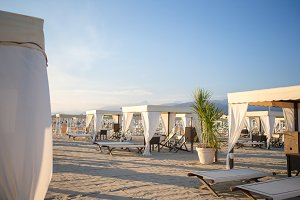 Wooden sunbeds in the evening soft light. Sunbeds in famous italian sand beach at Forte dei Marmi