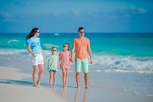 Happy beautiful family on a tropical beach