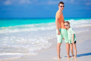 Family on the seashore. Father and daughter enjoy vacation on the beach