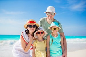 Portrait of beautiful family on the beach vacation