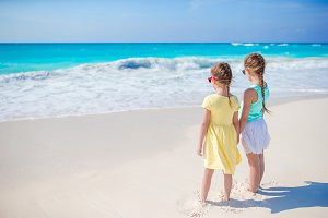 Adorable little girls together on the seashore