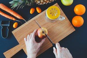 Hands Cutting Fruit - Juice Organic
