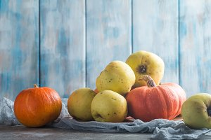 Fresh orange pumpkins and apples