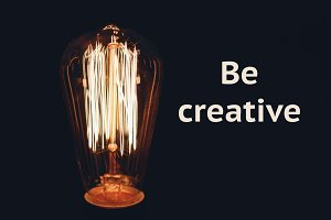 Inscription Be creative on the image of retro bulb on a black background. Creativity concept.