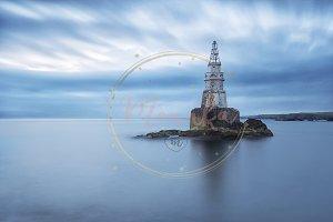 Misty sunrise of the lighthouse