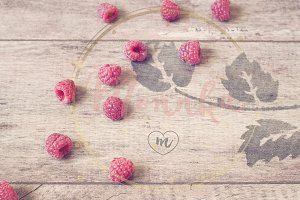 Raspberries on a wooden background