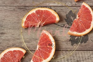 Grapefruit on a wooden background
