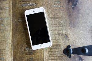 iPhone 6 Plus on Wood Table